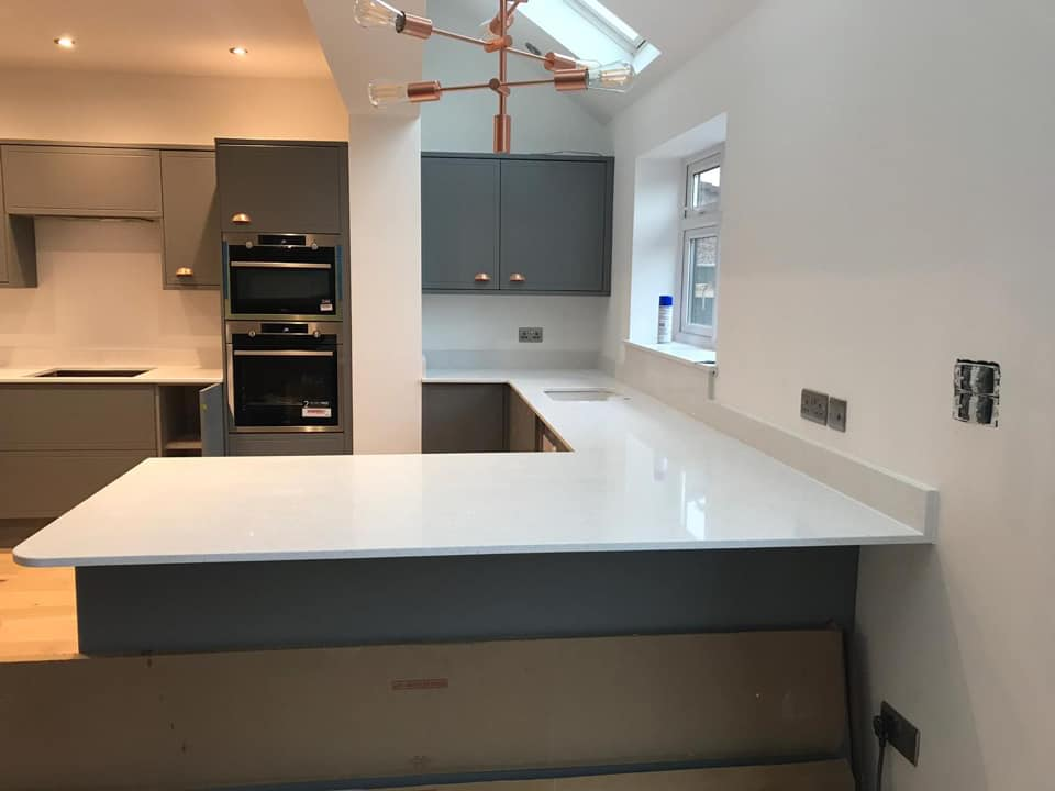 white stone kitchen worktop- quartz fitting in Kent.